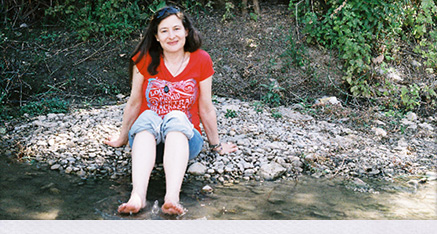 Gill Parry cooling her feet in a stream.