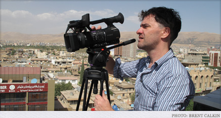 Mark Cousins with his camera in a middle-eastern city.